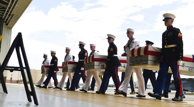 US welcomes home remains of presumed war dead from North Korea
