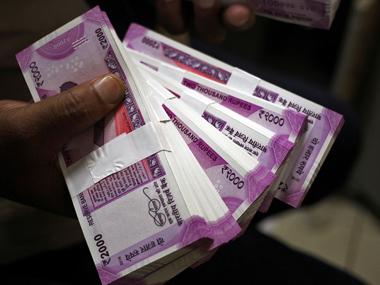 Rupee hits new all-time low of 70.32 on strong dollar demand; spike in trade deficit to five-year high